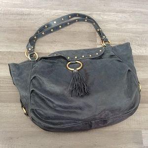 Fossil black leather tassel magnetic purse